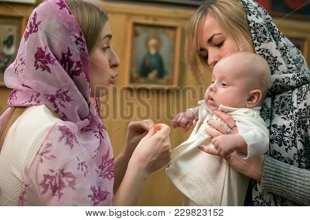 Belarus, Gomel, February 24, 2018. Church Of The Birches.baptism Of The Baby. Mother And Godmother W