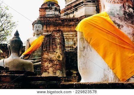 Monuments Of Ancient Buddha Statues At Wat Yai Chai Mongkol In Ayutthaya, Thailand, Travelling Thail