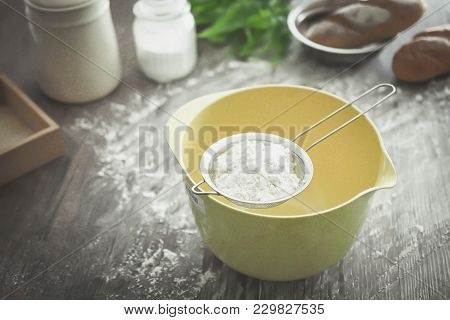 Sieve Flour Place On Mixing Bowl And Ingredients. Bakery Tools,food.