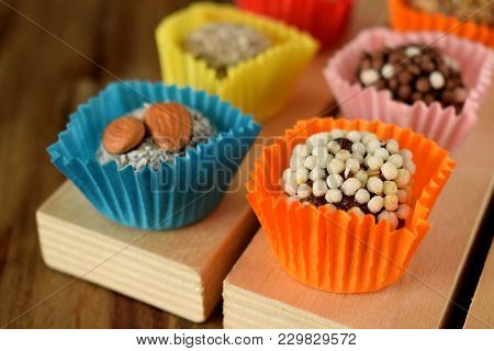 Set Of Sweets Made Of Dried Fruits With Different Sprinkles. East Dessert