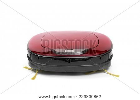 a robotic vacuum cleaner on a white background