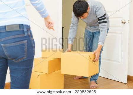 Deliveryman  Holding Boxes Into Customer Home - Receiving Package