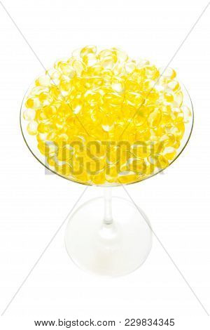Fish Oil Soft Capsule In Cocktail Glass With Clipping Path Isolated On White Background.