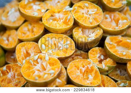 Pile Of Bright Freshly Squeezed Orange Rinds At An Outdoor Juice Stand