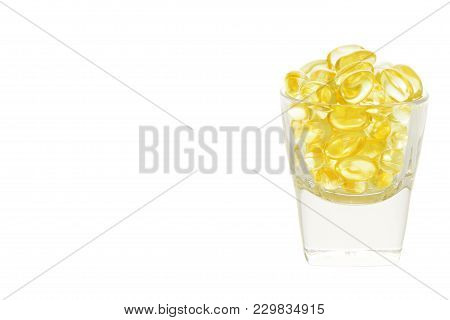 Fish Oil Soft Capsule In Glass With Clipping Path Isolated On White Background.with Copy Space