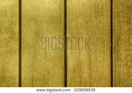 Orange Abstract Background Texture Of Wooden Decking With Parallel Planks With Gaps.