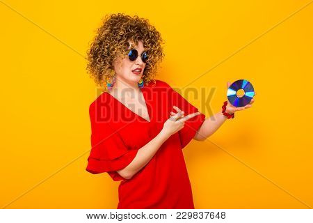 Attractive Woman With Curly Hair With Disc
