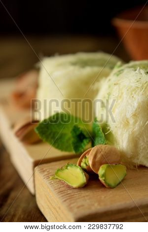 Turkish Dessert. Cotton Candy With Pistachio On Wooden Boards Surrounded By Nuts