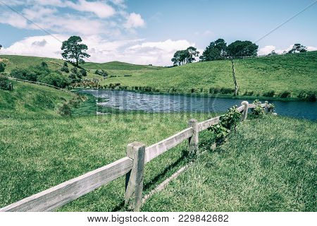 Green Grass Field In Countryside In Vintage Tone