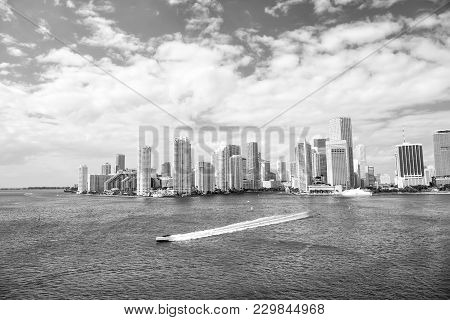 Aerial View Of Miami Waterfront Skyline Downtown At Sunny Day. Florida Speedboat Sailing Next To Por