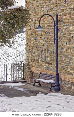 Small Corner, With A Bench And Street Lamp, In The Hilly Region Of Langhe (in The Southern Area Of P