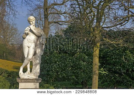 Marble Statue Of The Naked God Pan Playing A Flute In The Queens Garden Behind Kew Palace At The Roy