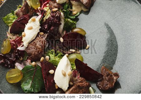 Restaurant Dish Background. Warm Grilled Beetroot And Goat Cheese Salad. Healthy Exclusive Food On B