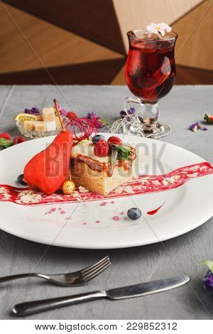Exquisite Restaurant Dessert. Caramel Milfuelle With Spicy Pear, Berry Sauce And Almond Flakes On Wh