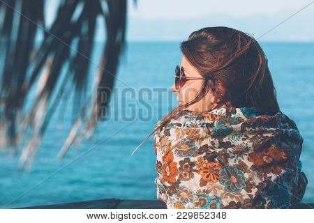 Young Woman Enjoying The View At The Beach Bar