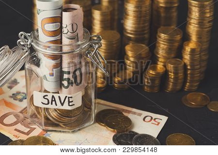 Coins In Glass Jar With Bills, Copy Space. Money Box, Saving Money For Dream, Pension, Vacation. Fin