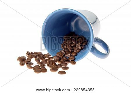 Isolated Coffee Grounds Spilled From A Blue Coffee Cup