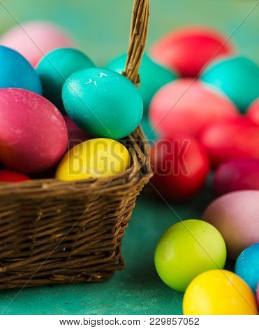 Multicolored Easter eggs on green background. Copyspace. Still life photo of lots of colorful easter