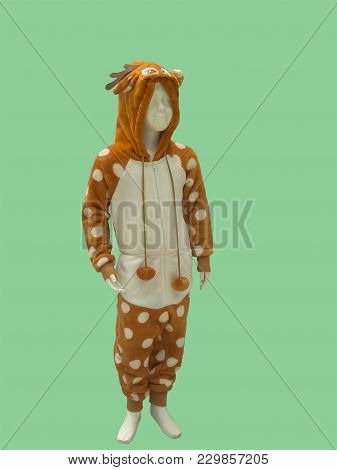 Child Mannequin Dressed In Leisure Wear, Isolated On Green Background. No Brand Names Or Copyright O