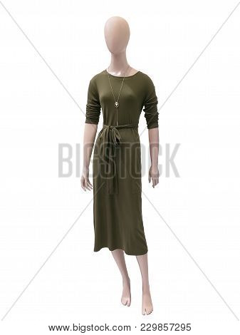 Full-length Female Mannequin Wearing Green Dress. No Brand Names Or Copyright Objects.