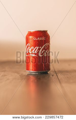 February 25th, 2018, Cork, Ireland - Coca Cola Can On Top Of A Wooden Table