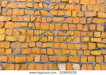 Orange Color Smalt On Gray Cement Wall.