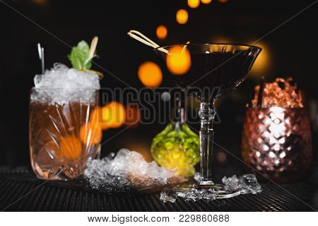 Different Cocktails On The Bar On Black Background
