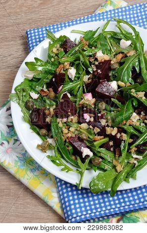 Beetroot Salad With Arugula With Feta And Capers, Sprinkled With Crushed Nuts