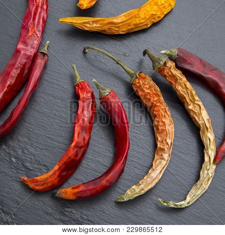 The Chilli Pepper - Sun-dried Is On Black Stone Background