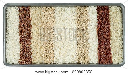 Ten Different Varieties Of Rice In Rectangular Dish Isolated On White Background.