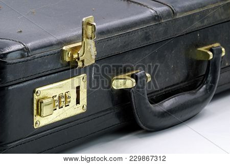Close Up Of An Old Leather Briefcase With Golden Combination Lock.