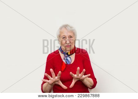 Senior Woman Studio Portrait With Disgust Emotions. Human Emotions Concept. Negative Emotional Old L