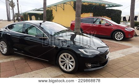 Menton, France - March 3, 2018: Luxury Black Tesla Model S And Red Tesla Model X Electric Cars Parke