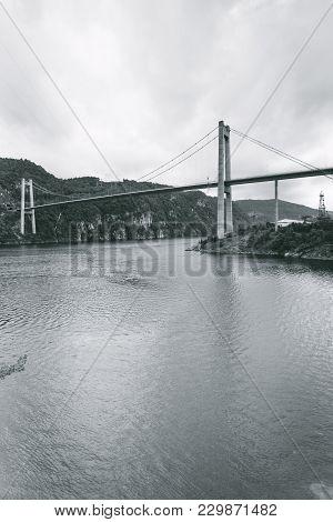 Suspension Bridge In Norway. Norwegian Infrastructure. Nature And Architecture.