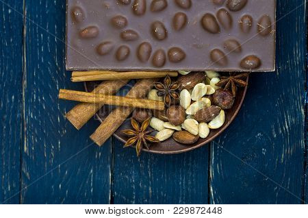 Whole Chocolate Bar With Nuts. Relief Milk Chocolate. Flat Lie. Low Key