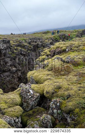 Thingvellir, Iceland - July 19, 2017: People Walking In A Fault Line, Thingvellir National Park, Ice