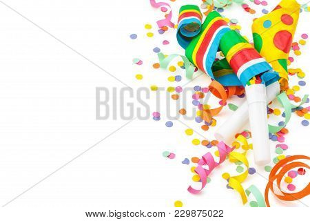 Noisemakers, Streamers And Confetti. Isolated On White Background