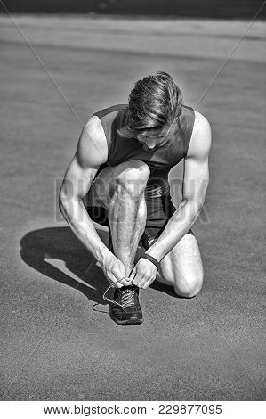 Summer Activity And Sport, Runner, Bearded Man Or Sexy Handsome Guy With Athletic Body Tie Shoe Lace