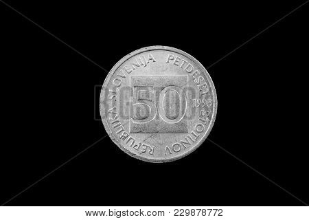 A Macro Image Of A Slovenian 50 Stotin Coin Isolated On A Black Background