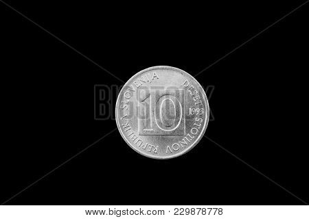 A Macro Image Of A Slovenian 10 Stotin Coin Isolated On A Black Background