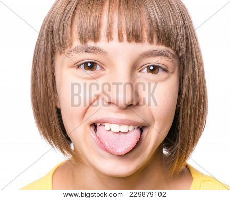 Nice Girl Showing Her Tongue. Child Puts Out Tongue - Close Up.