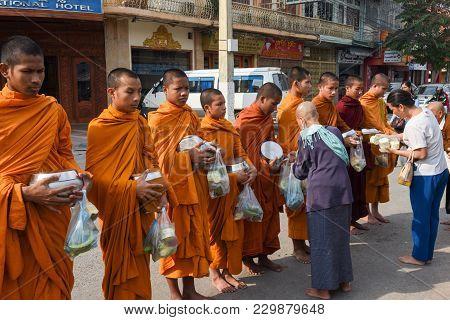 Monks During Food Gathering At Battambang On Cambodia