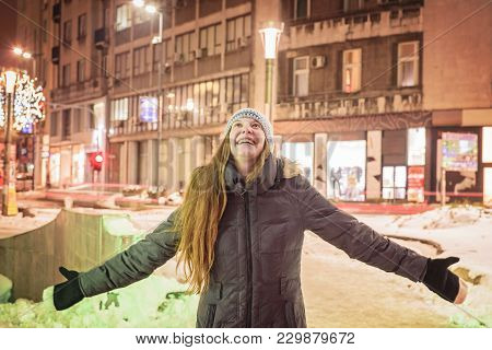 Young Happy Woman Celebrating Winter, Enjoying A Night Out In A City