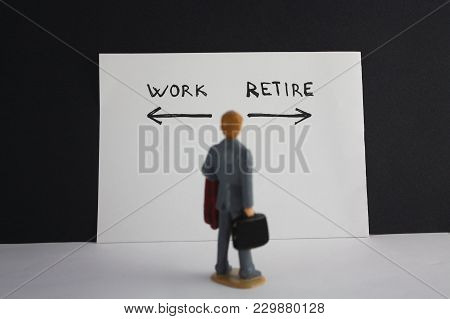 Man Looks To Work And Retire Inscription With Arrows. Retirement Concept.