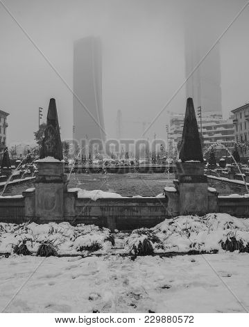 Milan, Italy - March 1st, , 2018: Fountain Of The Four Seasons In Piazza Giulio Cesare, Citylife, Wi
