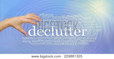 Choose To Declutter Your Life And Feel The Effect - Female Hand About To Pick Up The Word Declutter