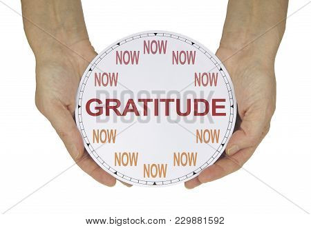 Cultivate A Gratitude Attitude Now  - Female Hands Holding A Clock With No Hands That Has Now In Pla