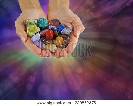 Crystal Healer Offering Selection Of Tumbled Healing Stones - Female Crystal Therapist With Cupped H