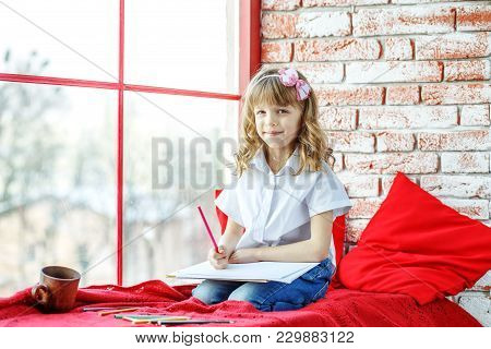 A Little Child Paints And Sits On The Windowsill. Conception Childhood, Learning, Drawing, Hobbies,