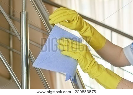 Hands In Rubber Gloves, Cleaning. Maid Using Rag. How To Clean Metal Surfaces.
